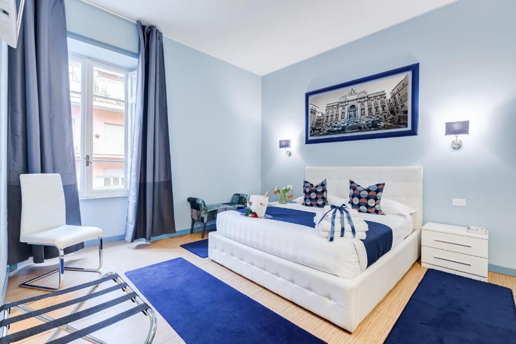 Cama ou camas em um quarto em Easy Budget Colosseo