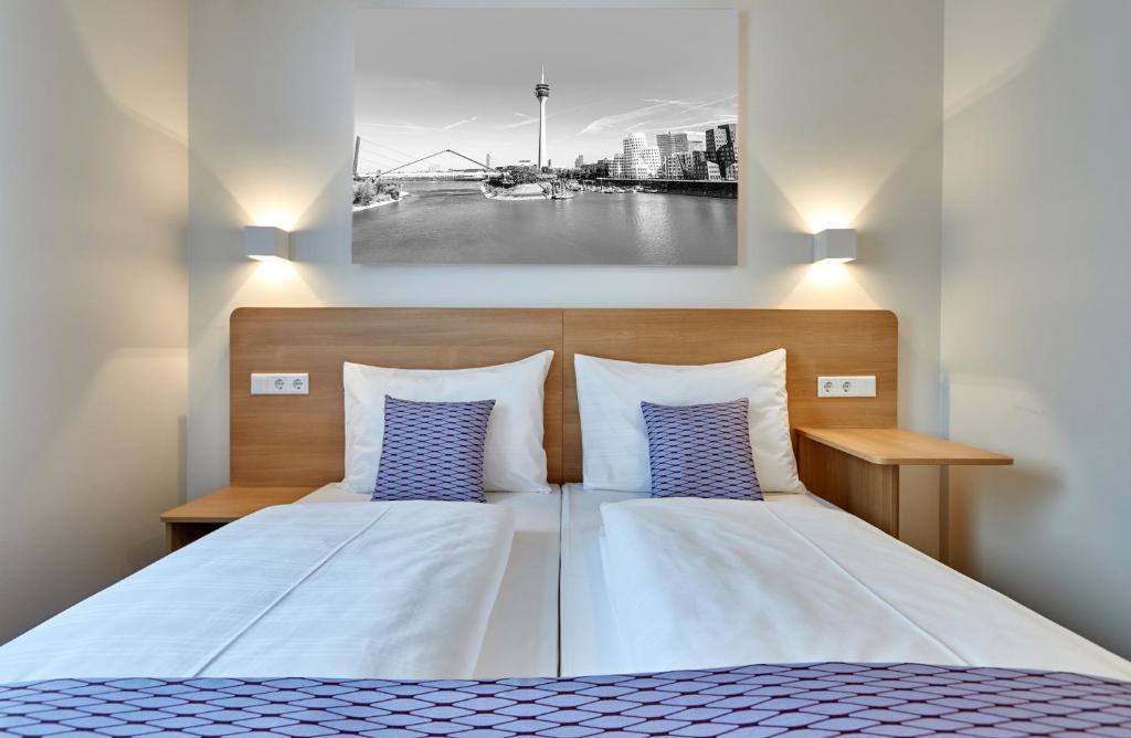 Lova arba lovos apgyvendinimo įstaigoje McDreams Hotel Düsseldorf-City
