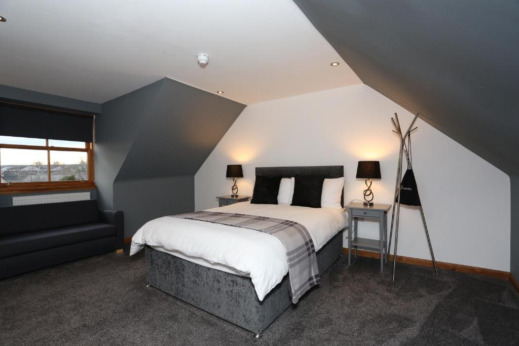 A bed or beds in a room at The Square Rooms.