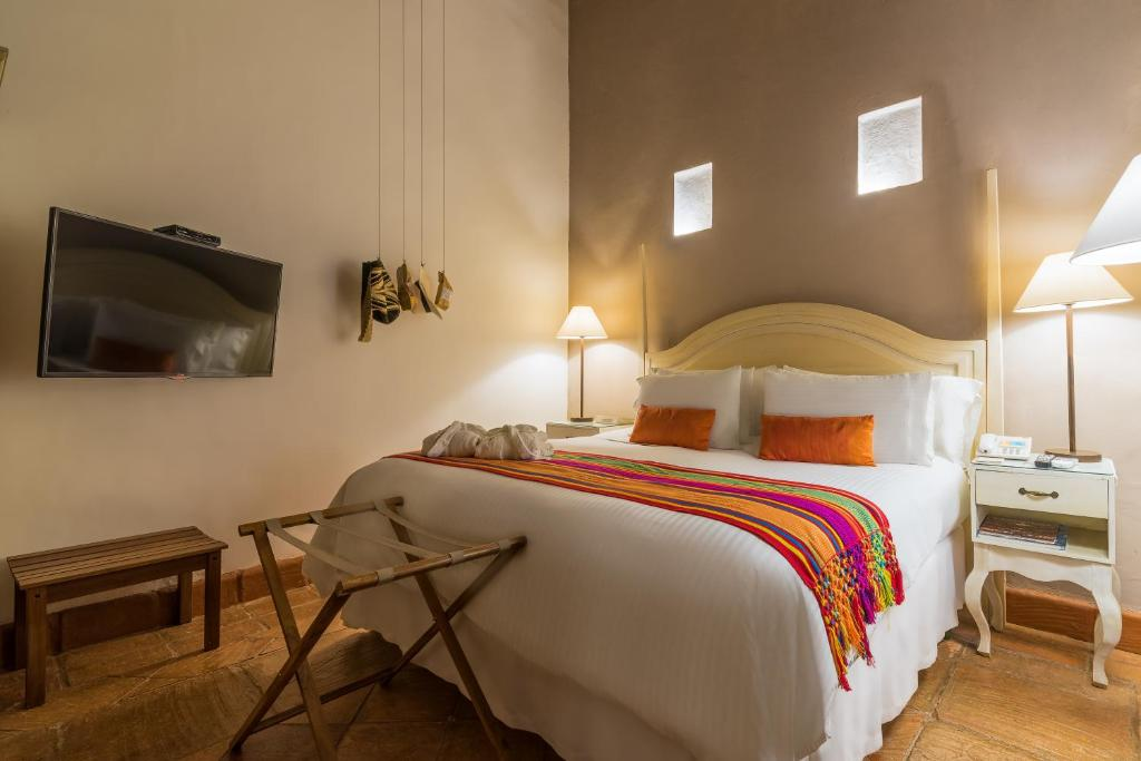 A bed or beds in a room at Bantu Hotel By Faranda Boutique