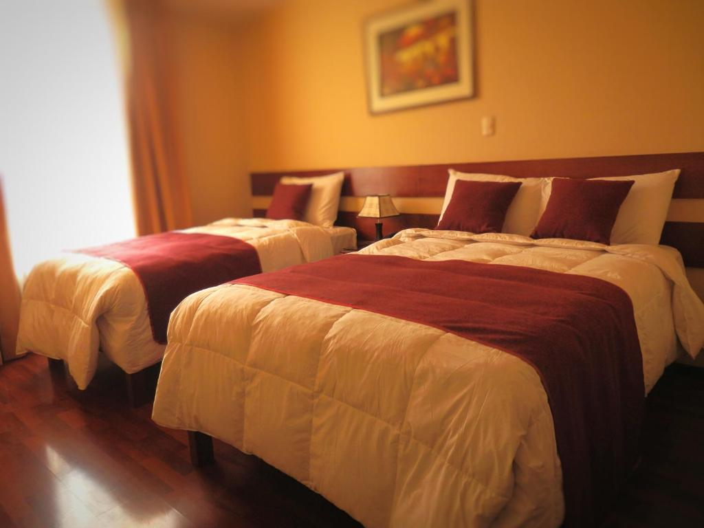 A bed or beds in a room at Bella AQP