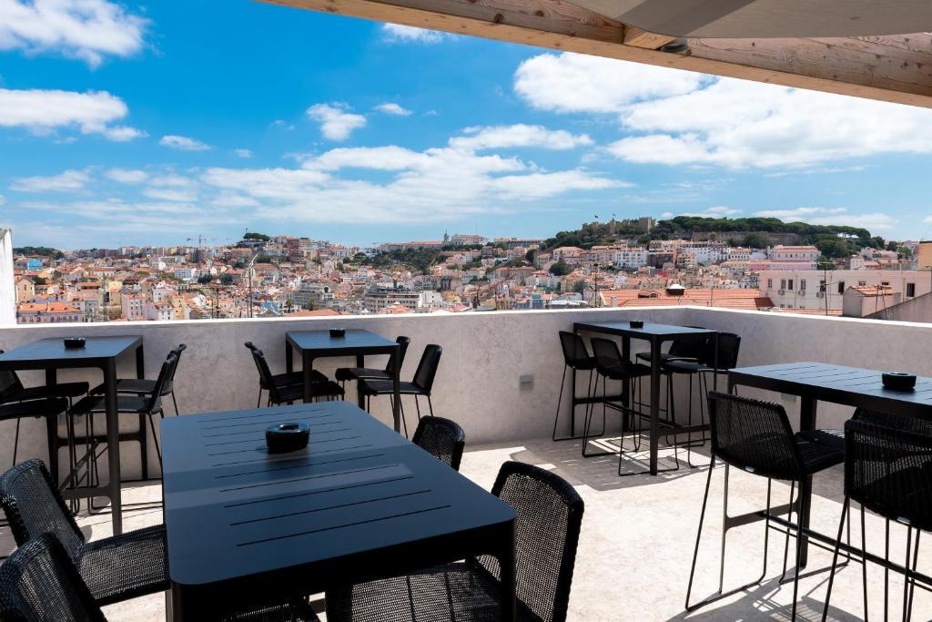 A balcony or terrace at Lisboa Pessoa Hotel