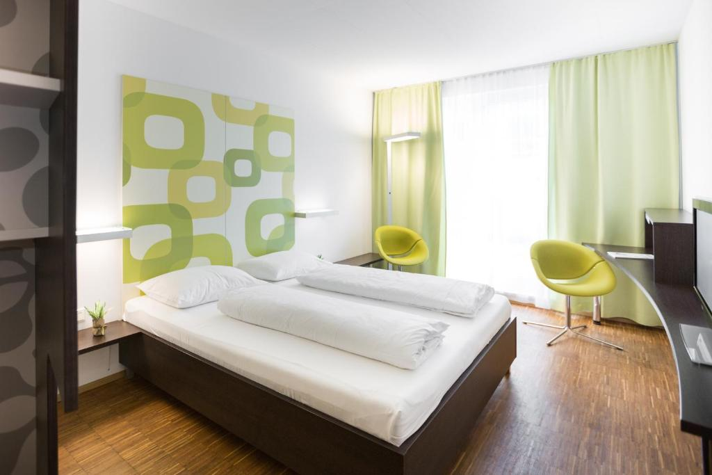 A bed or beds in a room at arte Hotel Krems