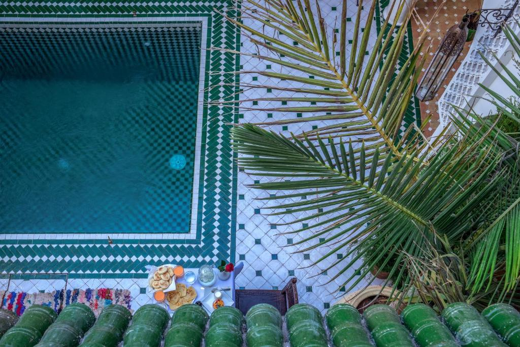 A view of the pool at L'Oriental Medina Riad & Spa or nearby