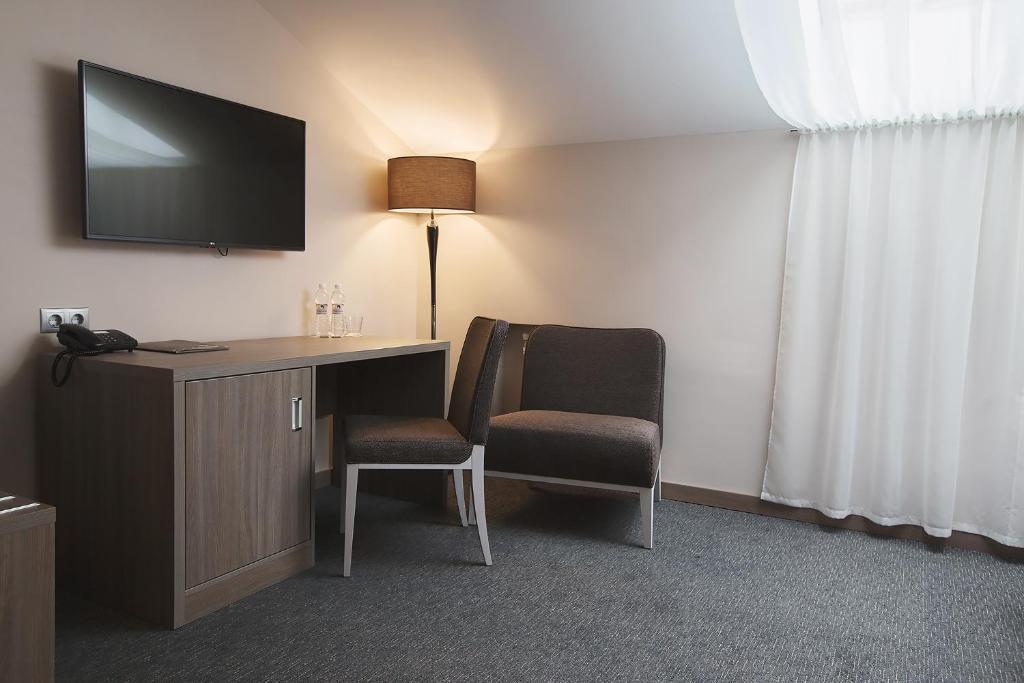 Телевизор и/или развлекательный центр в Hotel Pokrovsky