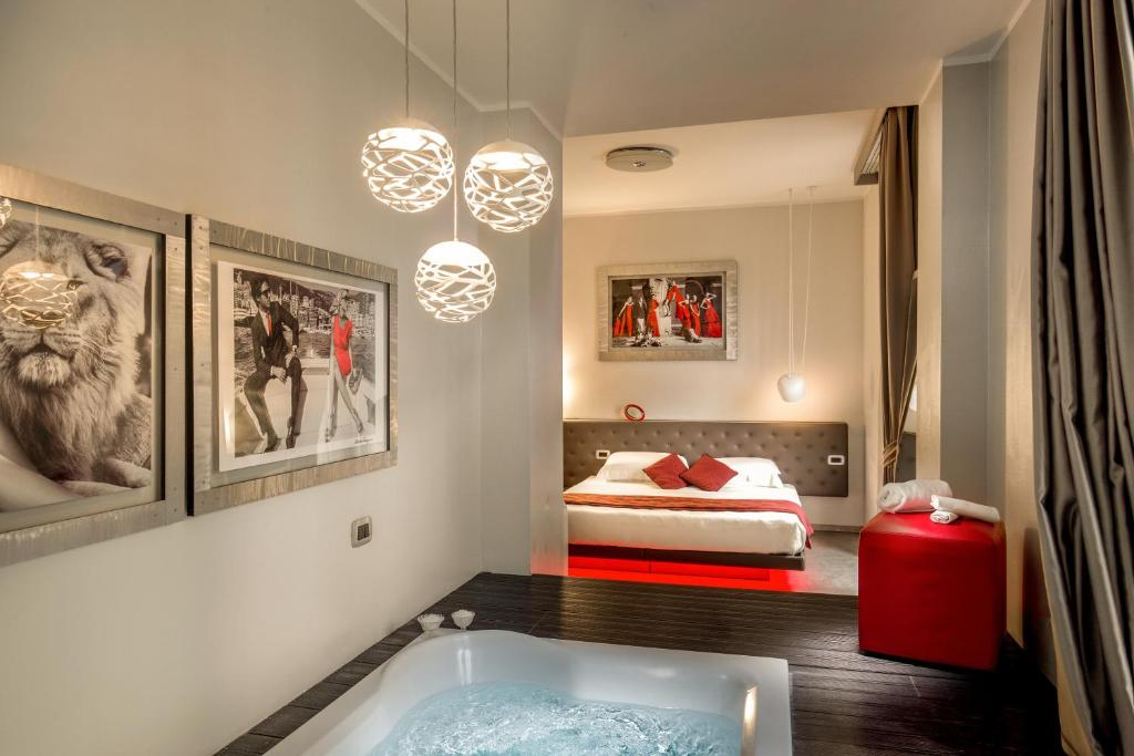 A bed or beds in a room at Montenapoleone Suites
