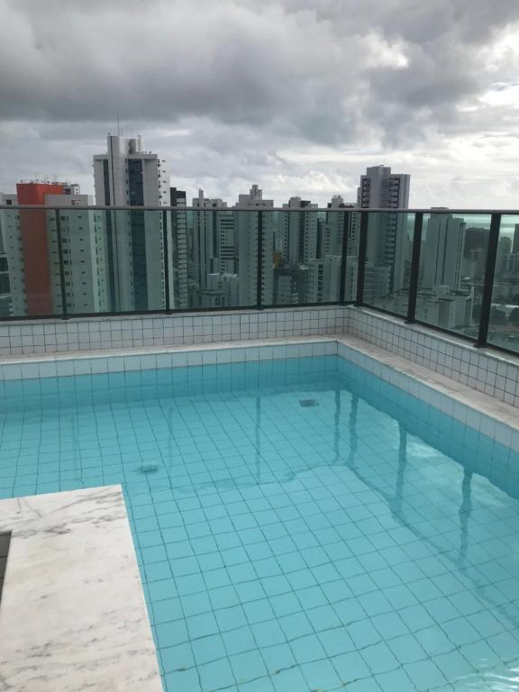 The swimming pool at or close to studio golden breeze boa viagem