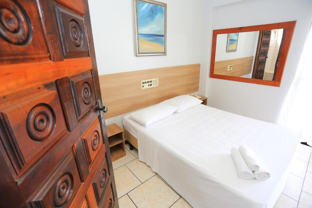 Cama o camas de una habitación en Rede Andrade Lumar