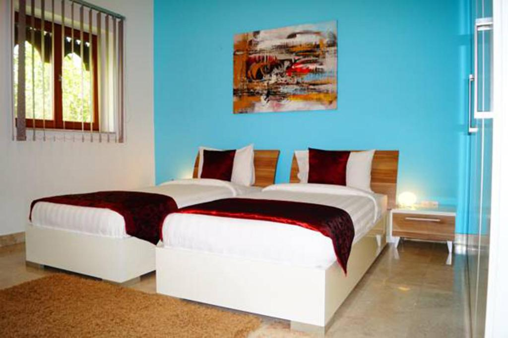 A bed or beds in a room at Le Sifah Resort Apartments