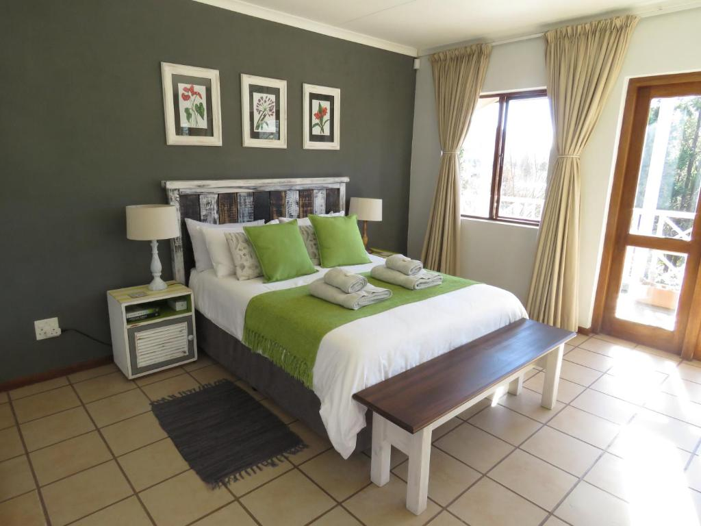 A bed or beds in a room at Fairview Cottages