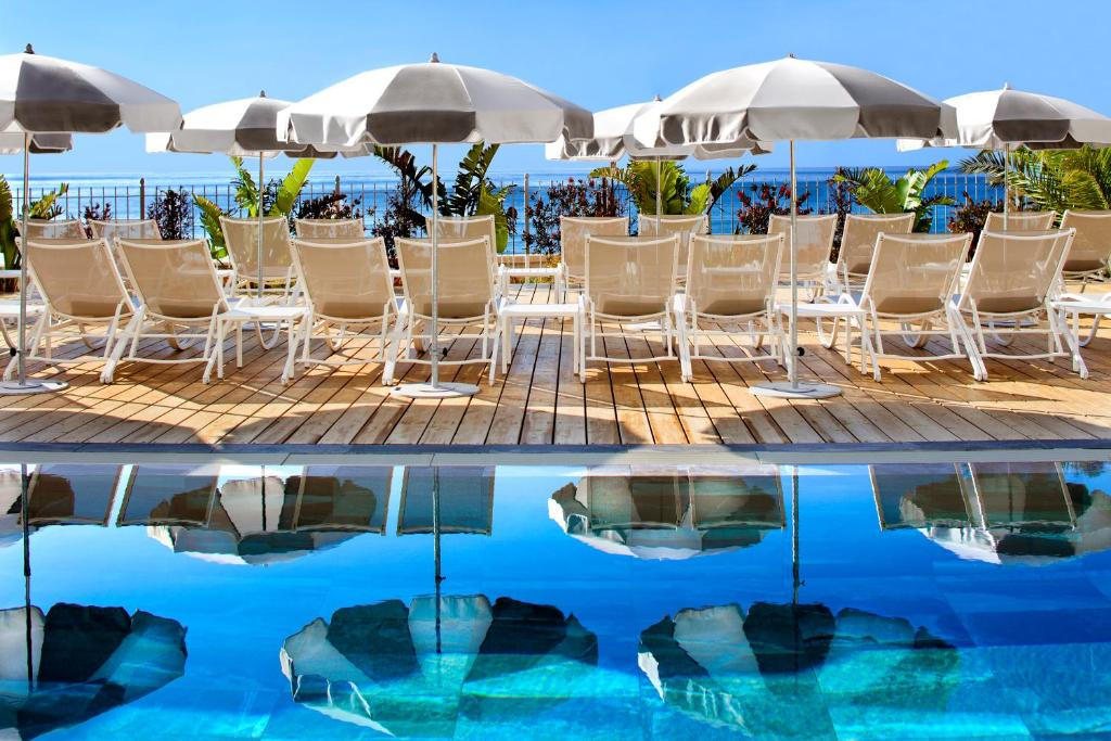 The swimming pool at or near Grand Hotel Des Sablettes Plage, Curio Collection By Hilton