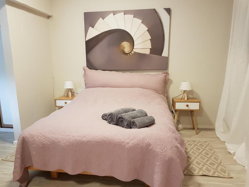Ein Bett oder Betten in einem Zimmer der Unterkunft Best central location to tour Israel