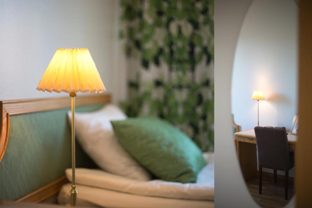 Säng eller sängar i ett rum på Hotel Milton