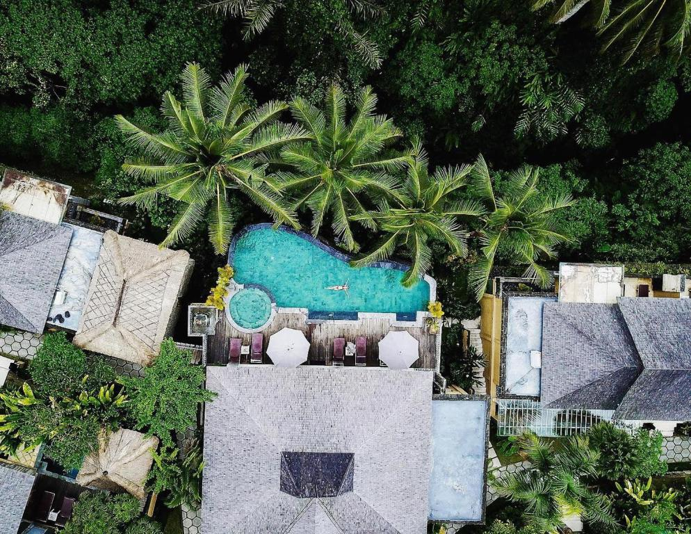 A view of the pool at Wapa di Ume Ubud or nearby