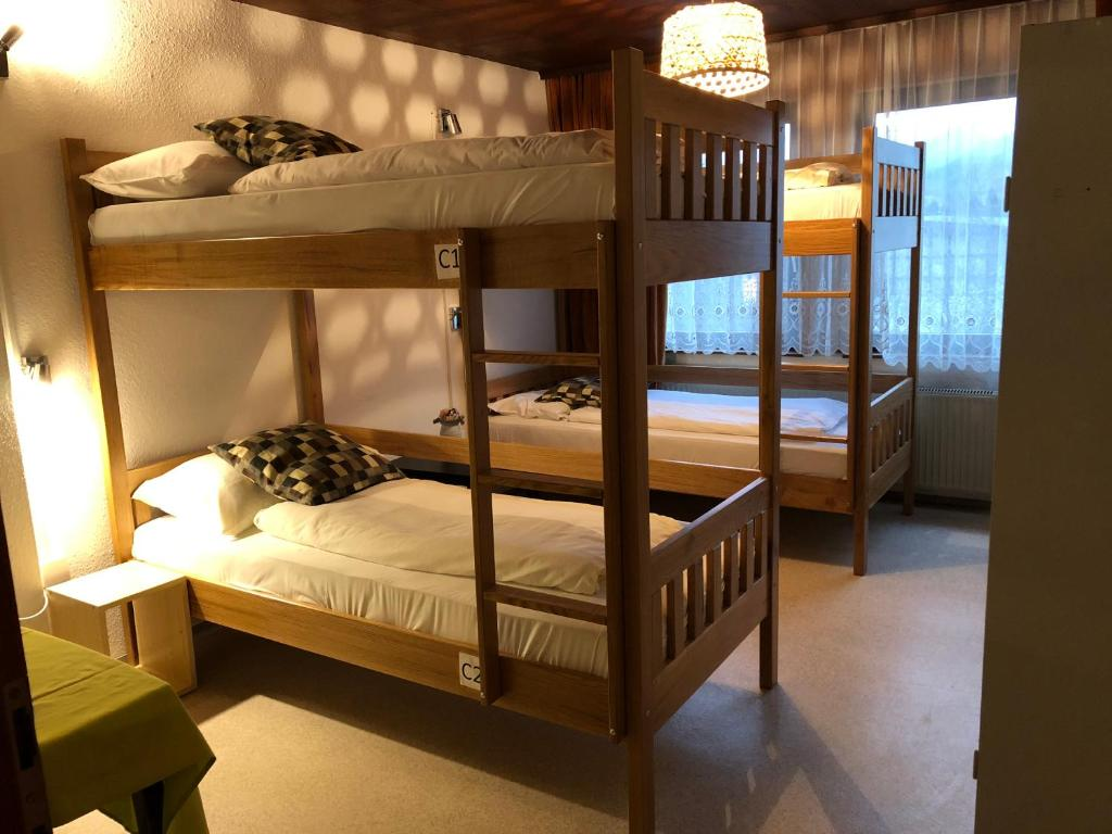 A bunk bed or bunk beds in a room at Central Hostel Bled