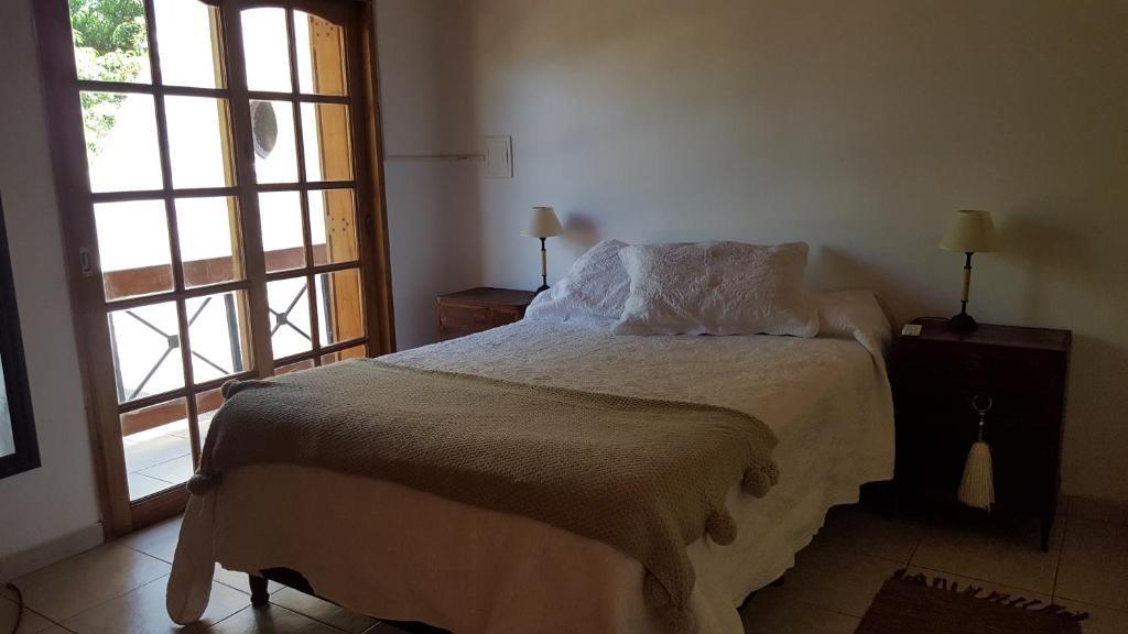 Una cama o camas en una habitación de Duplex Vanina