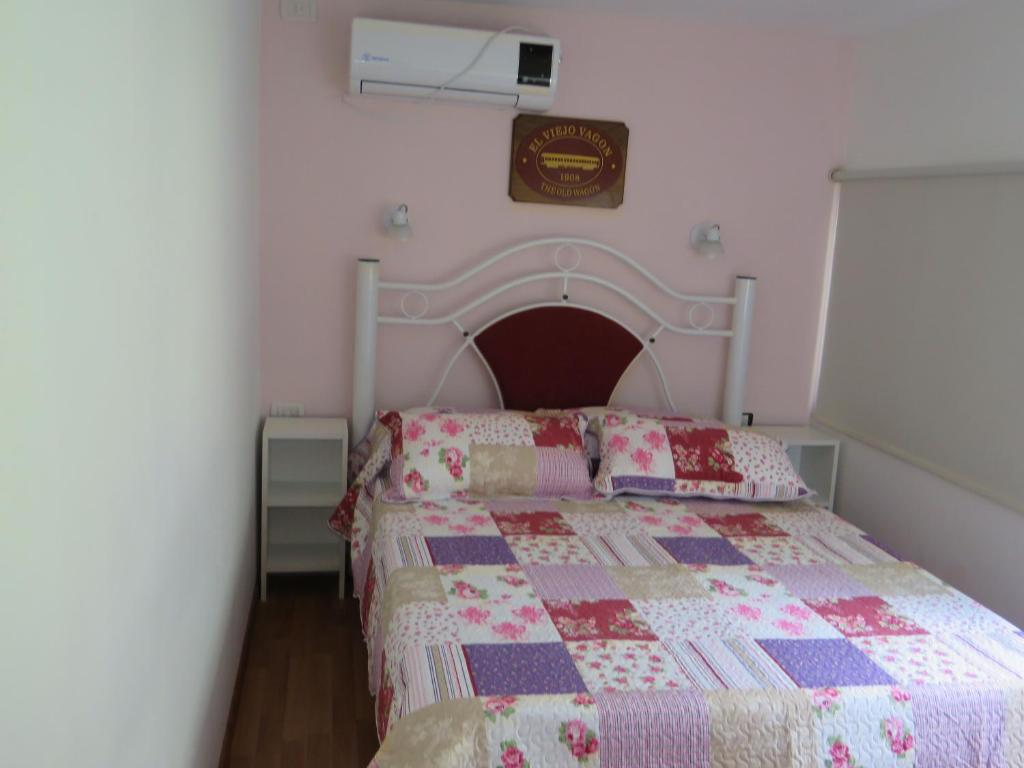 A bed or beds in a room at El Viejo Vagon 1908