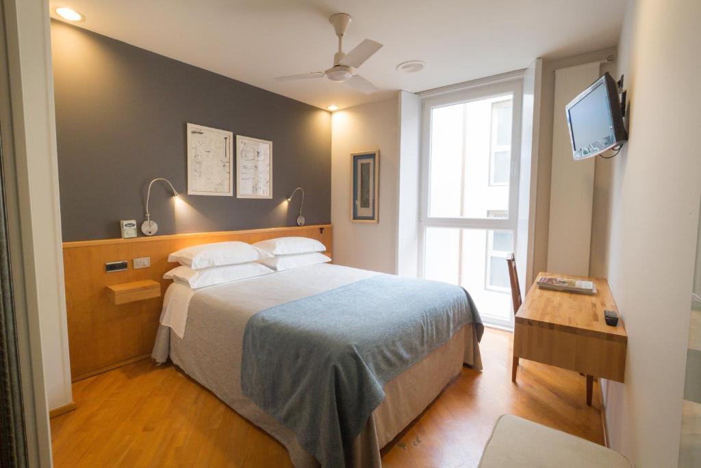 Cama o camas de una habitación en Hotel Zarampallo