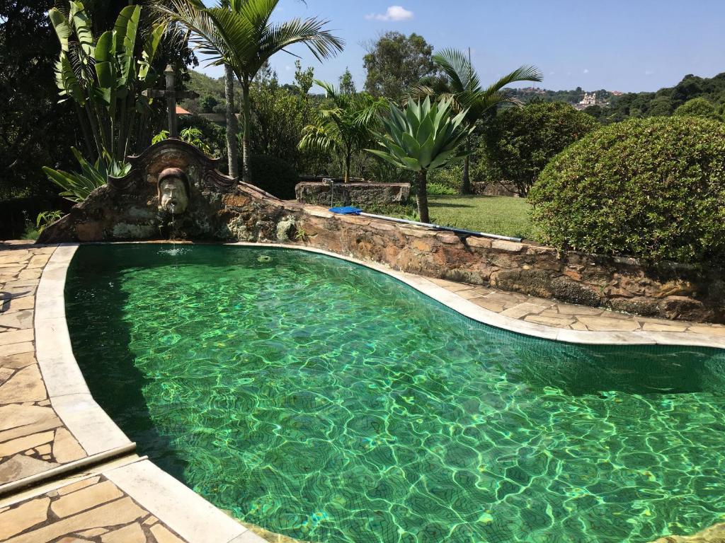The swimming pool at or near Pousada Casa das Fontes
