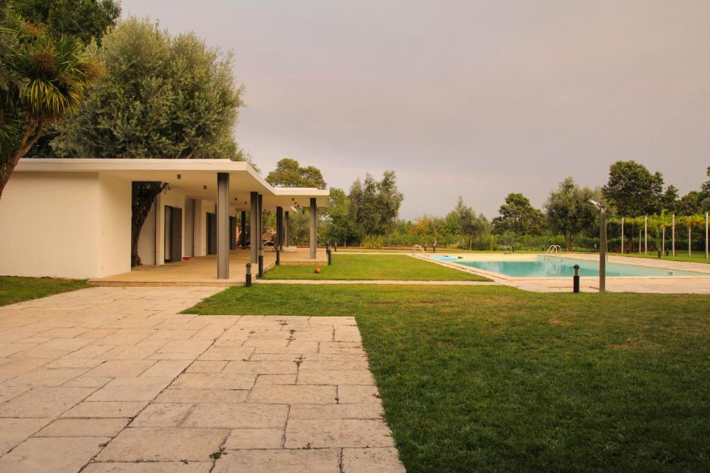 The swimming pool at or near ARTS IN Country House Linha do Dão