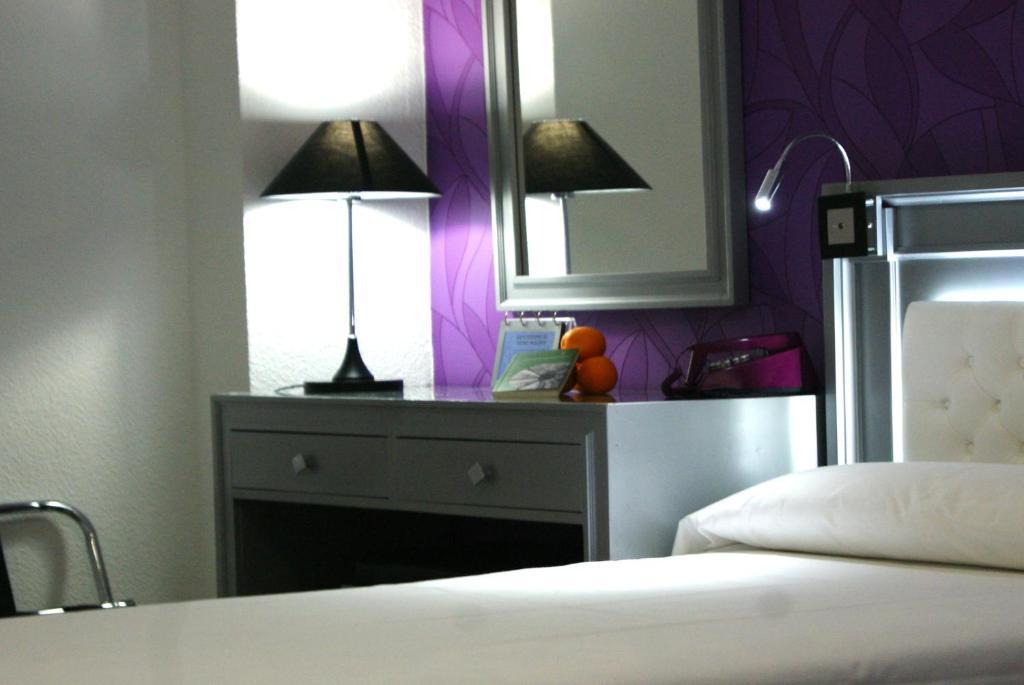 Cama o camas de una habitación en Hotel Molinos