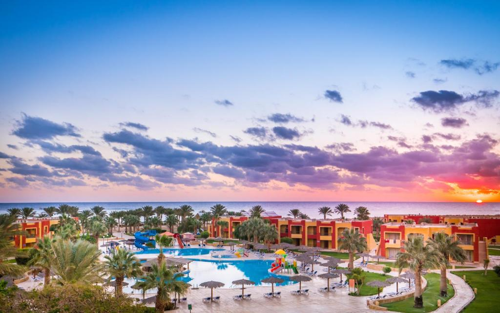 A view of the pool at Magic Tulip Beach Resort & Spa or nearby