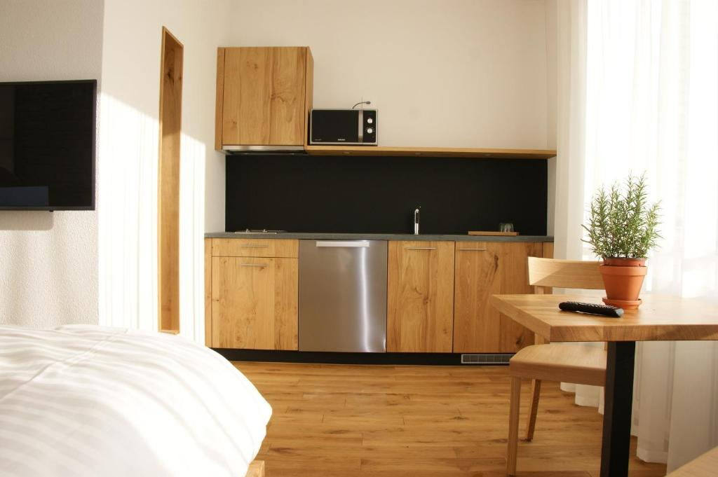 A kitchen or kitchenette at LOCAL Hotel