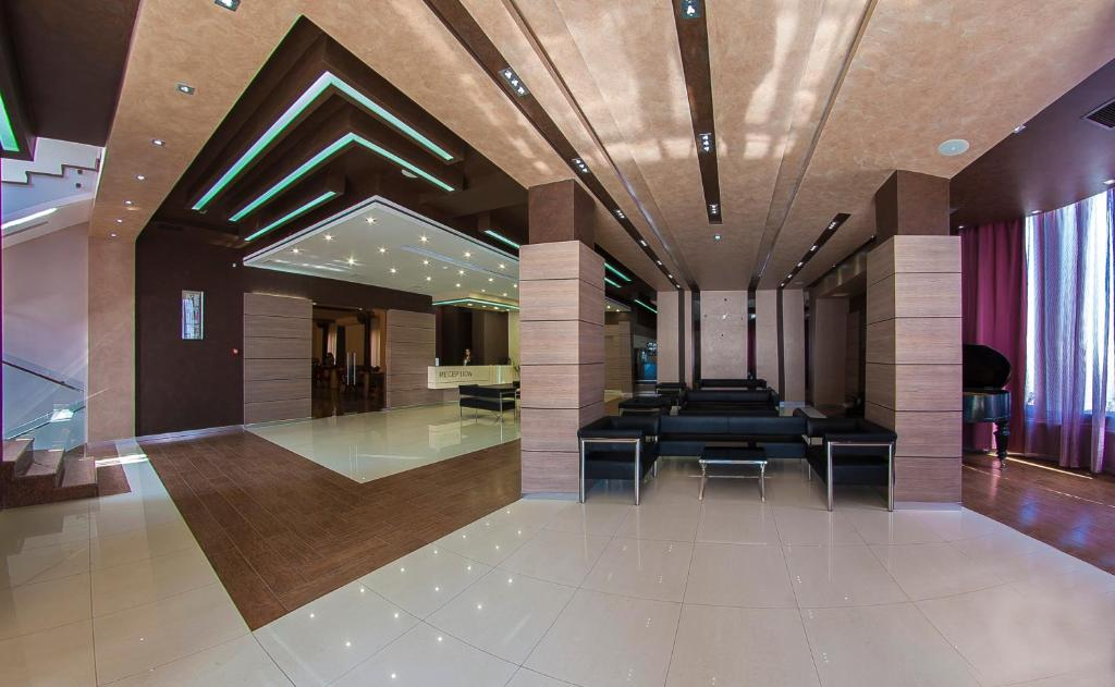 The lobby or reception area at Alpina Hotel
