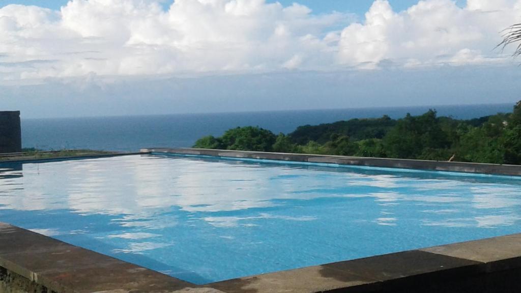 The swimming pool at or near Green Bowl Beach Villas