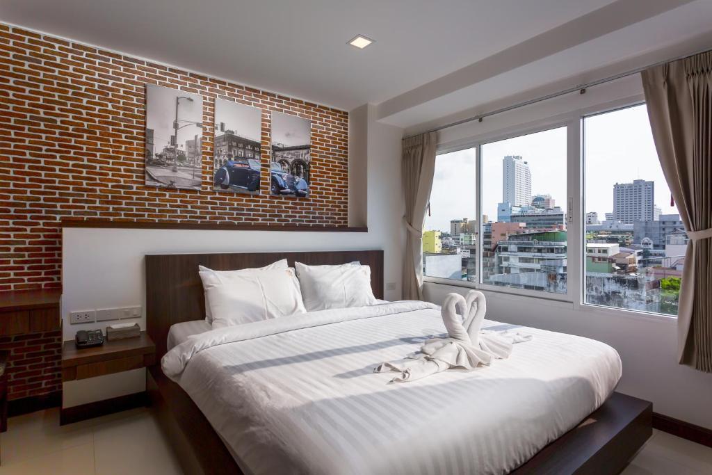 合艾友酒店房間的床
