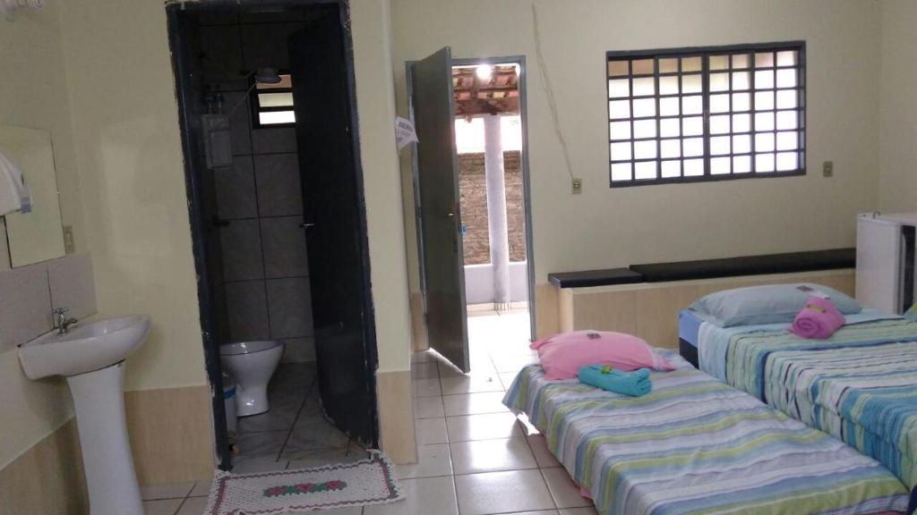 A bed or beds in a room at Pousada Agua Quente