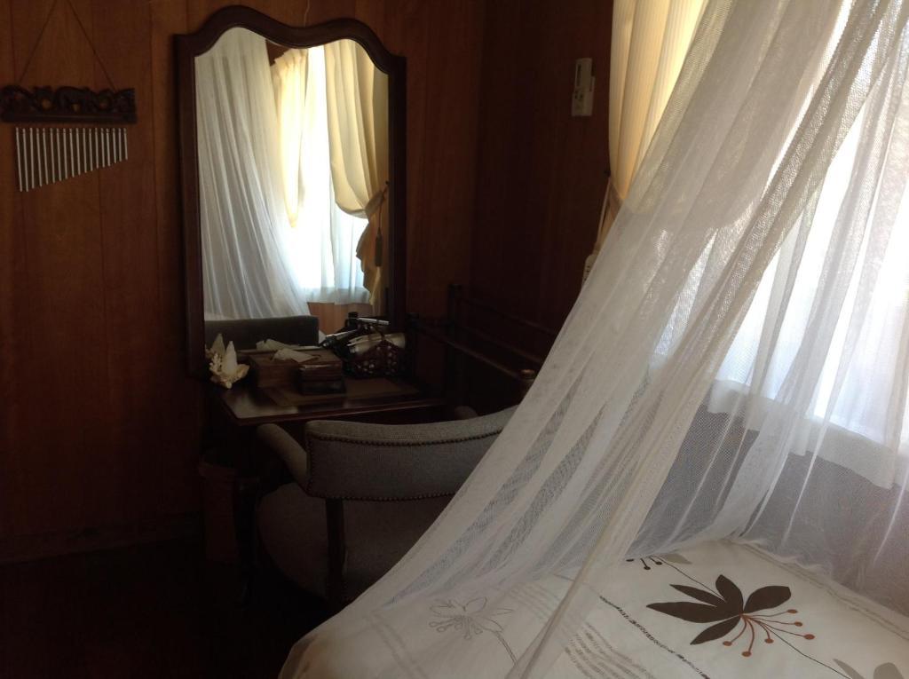 米爾可亞女性旅館房間的床