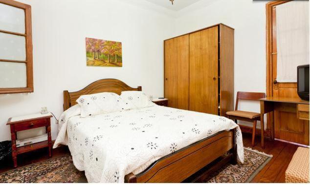Cama o camas de una habitación en Alojamiento Alberto Magno