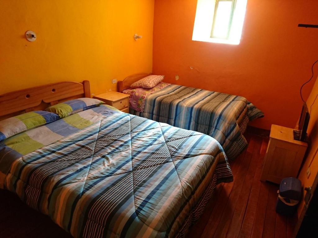 Cama o camas de una habitación en Qhapaq Wasi