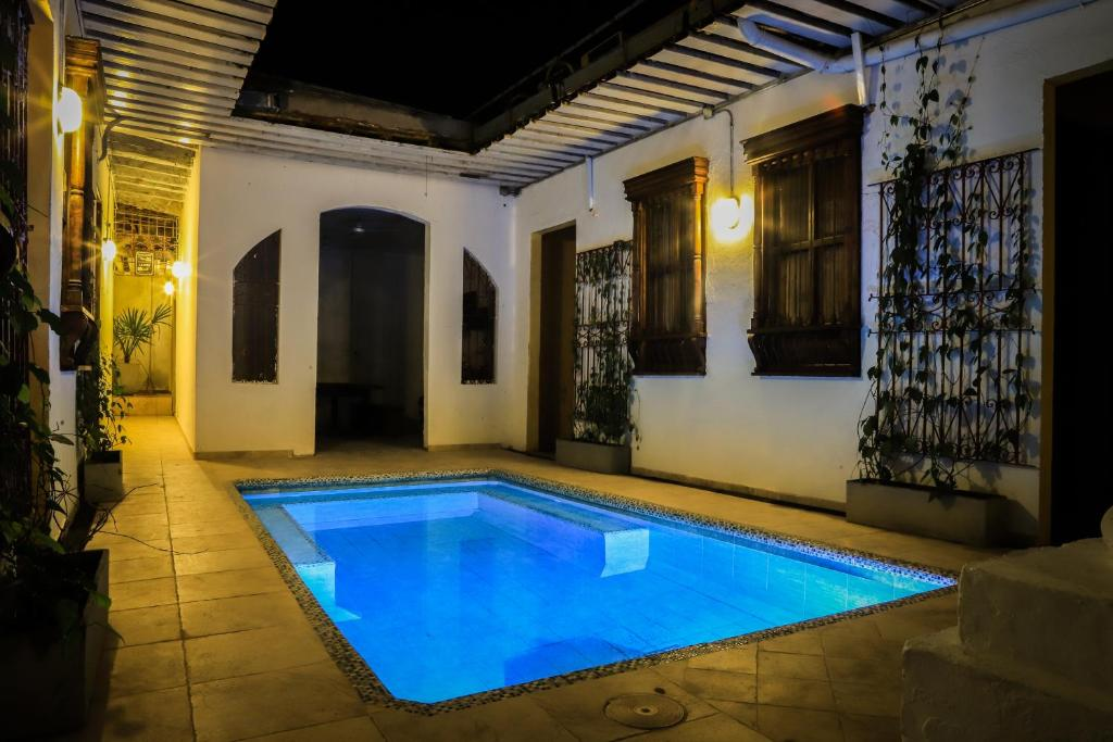 The swimming pool at or near The Pelican Larry Hostel & Dance School