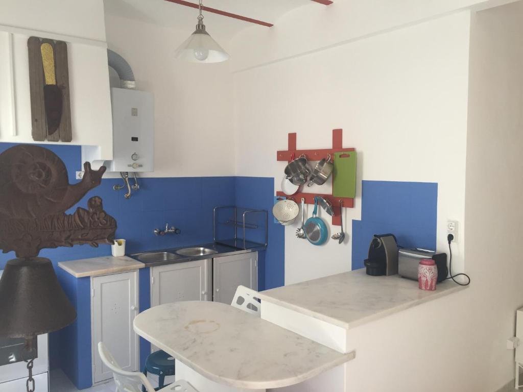 A kitchen or kitchenette at Casa do Cabo