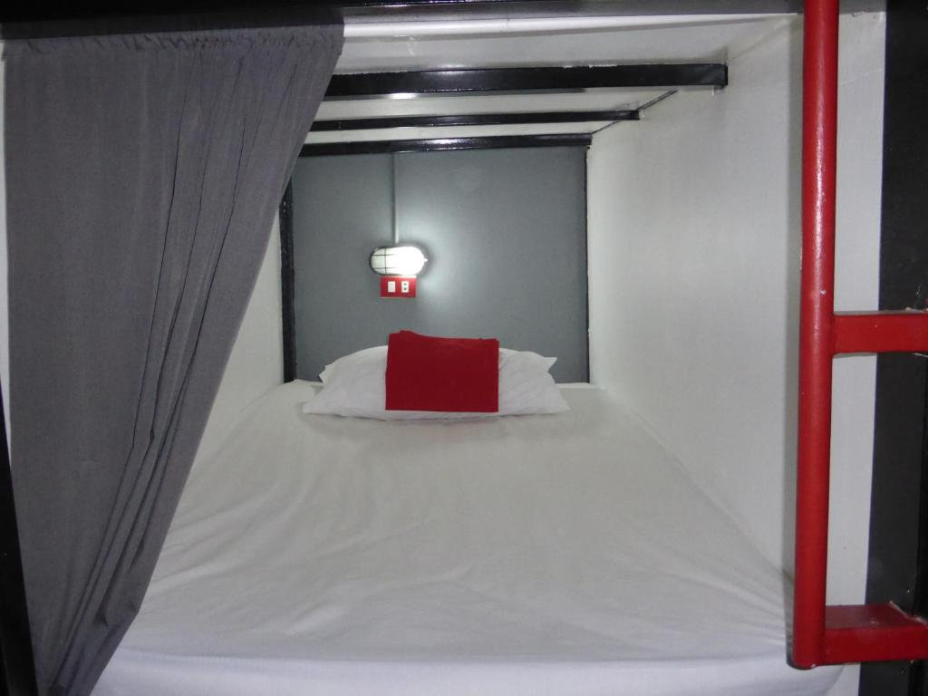 A bed or beds in a room at Dormsin Hostel