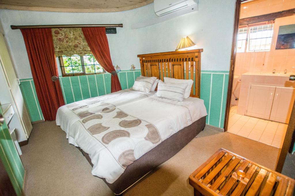 Voodi või voodid majutusasutuse Hoyohoyo Koeltehuis Farm Lodge toas