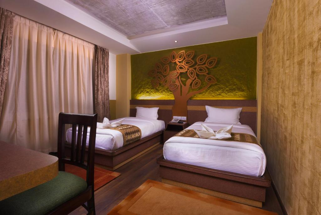 A bed or beds in a room at Bodhi Boutique Hotel