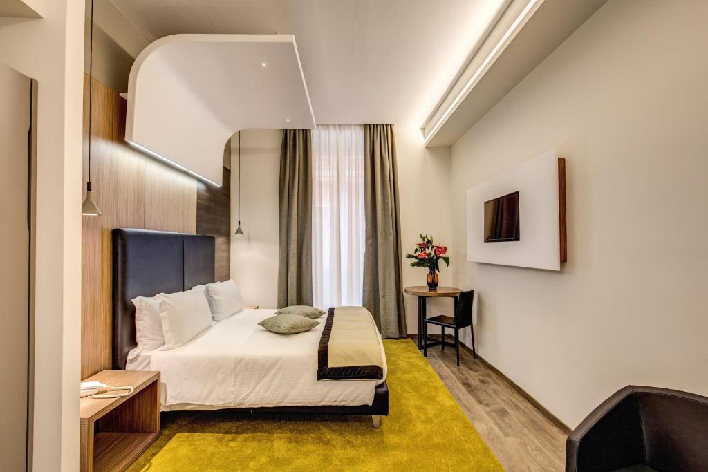 מיטה או מיטות בחדר ב-Trevi Collection Hotel - Gruppo Trevi Hotels