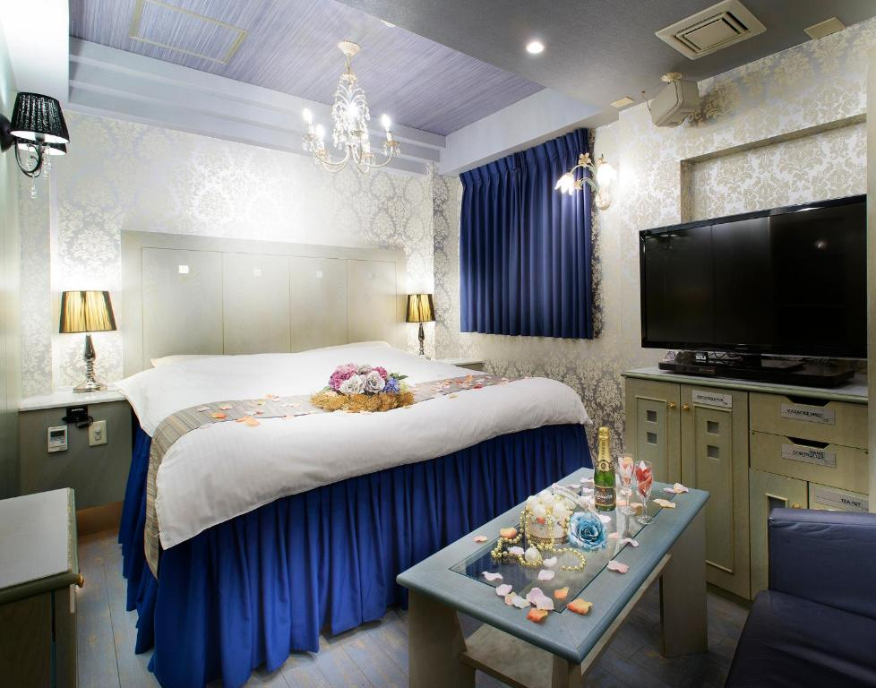 A bed or beds in a room at Hotel Chapel Christmas Umeda (Adult Only)