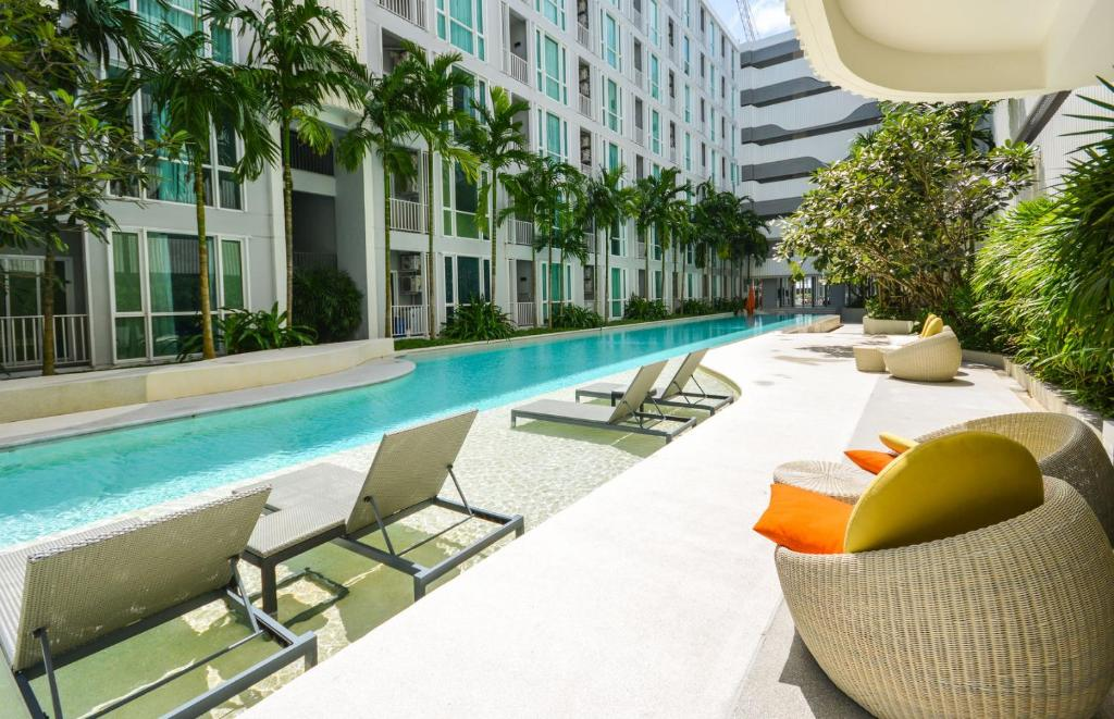 The swimming pool at or near Cozy Stay @ Central Shopping Phuket