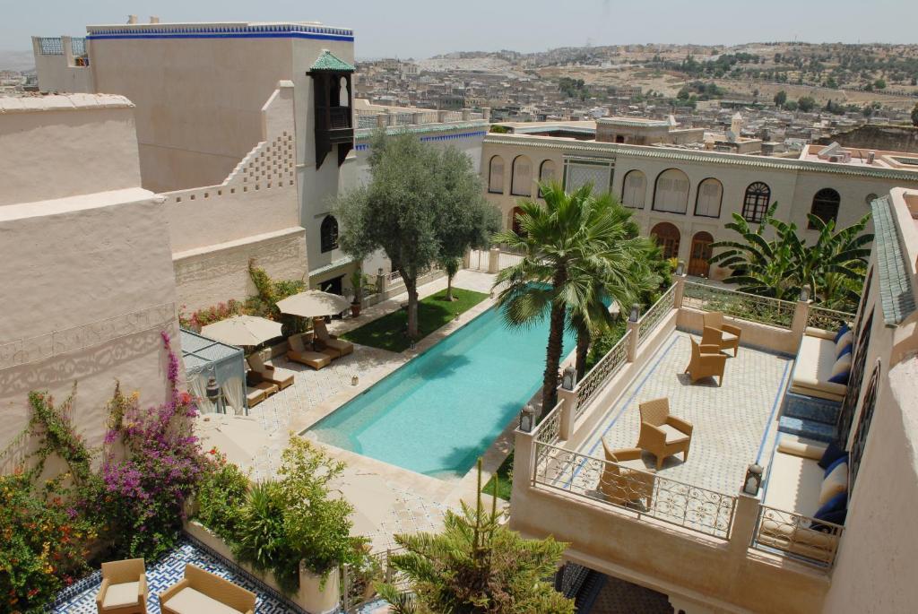A view of the pool at Riad Alkantara or nearby