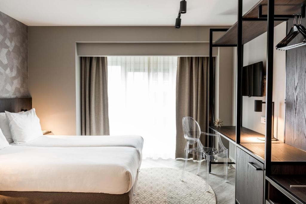 Een bed of bedden in een kamer bij Sandton Eindhoven Centre