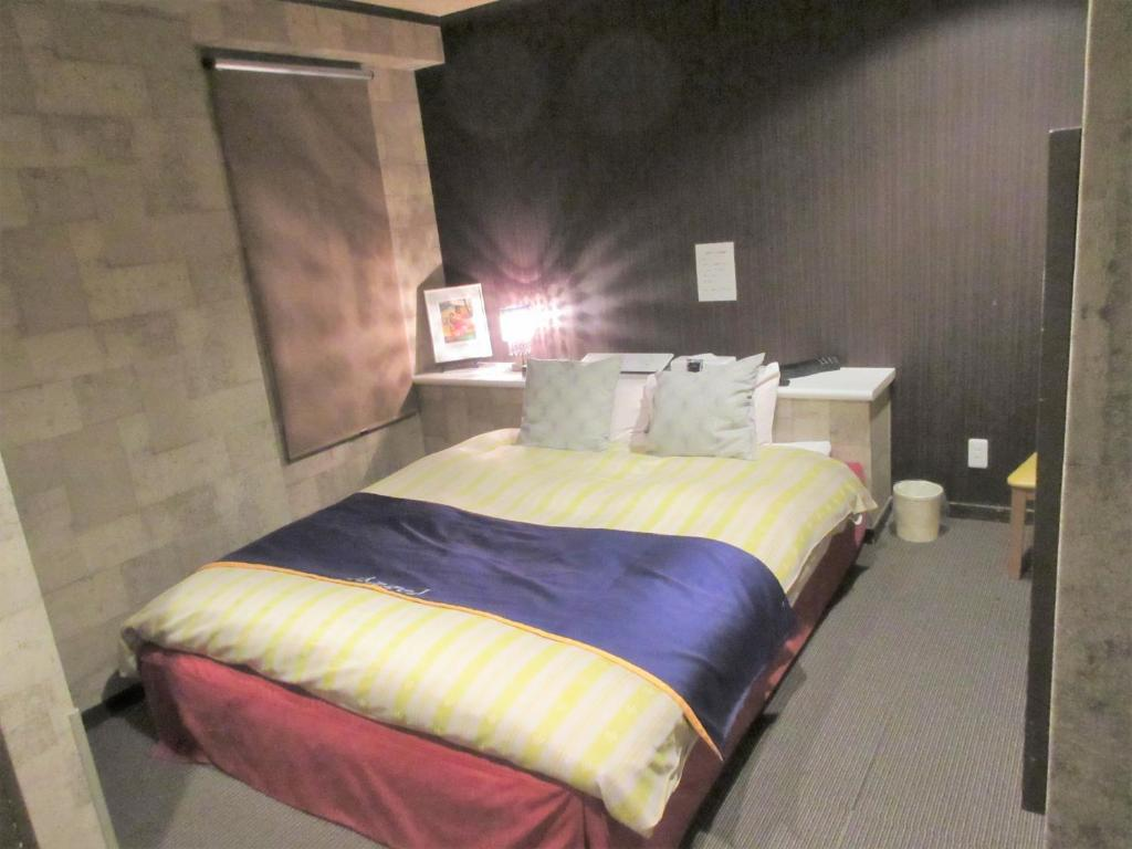 A bed or beds in a room at Hotel Angel (Adult Only)