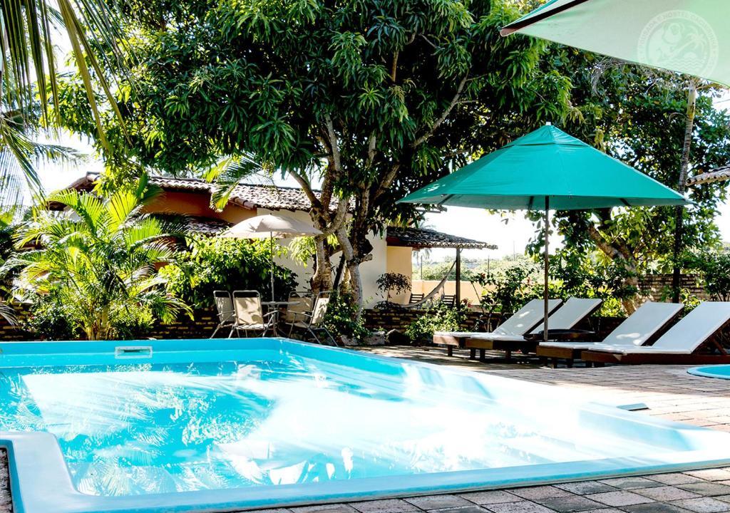 A piscina localizada em Pousada Cacimbinha ou nos arredores