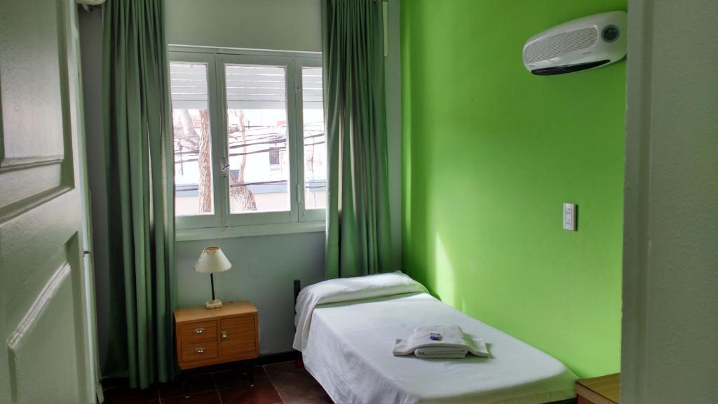 Una cama o camas en una habitación de Hotel La Toja
