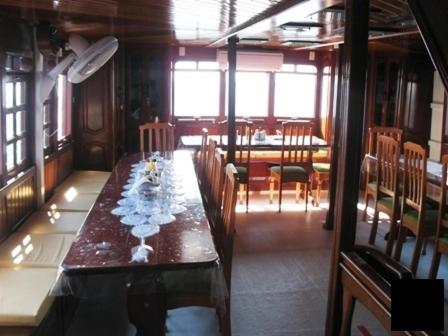 A restaurant or other place to eat at Amazonia Expeditions Boat