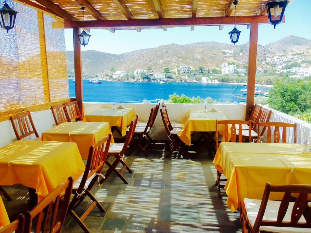 A restaurant or other place to eat at Alexandros Hotel