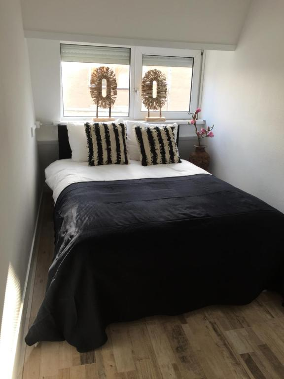 Un ou plusieurs lits dans un hébergement de l'établissement appartementen zeespiegel